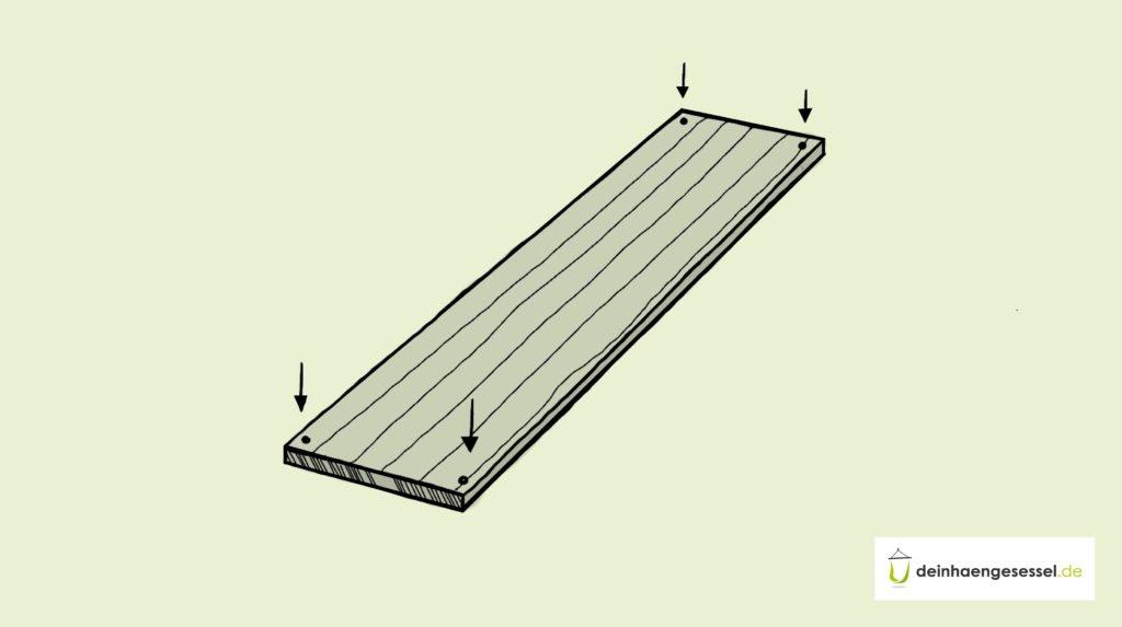 Zu sehen ist ein Holzbrett und vier Stellen, an denen gebohrt werden soll