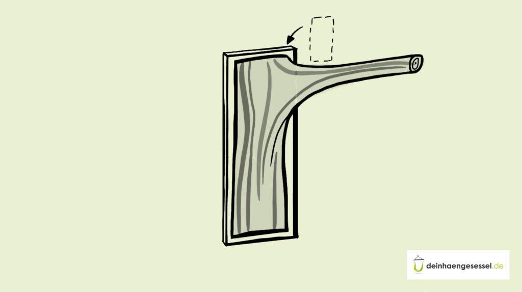 Zu sehen ist ein selbst gebautes Hängesessel Gestellt an einer Wand